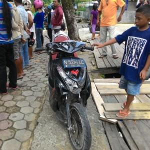 Kondisi motor milik Sudirman setelah menabrak mobil Toyota Innova (run)