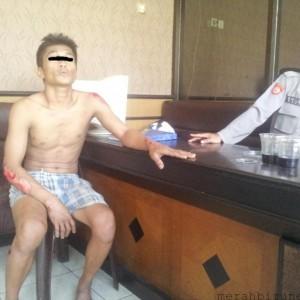 Sam saat diamankan di Kantor Polisi (ctr)
